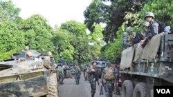 Pasukan FIlipina dikerahkan untuk mengamankan wilayah kota Talipao, di Pulau Jolo, FIlipina selatan yang diserbu oleh militan hari Minggu (25/9).