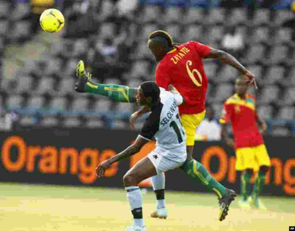 Guinea's Kamil Zayatte (6) challenges Botswana's Dipsy Selolwane during their African Nations Cup Group D soccer match Franceville Stadium January 28, 2012.
