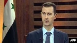 지난 8월 시리아의 한 텔레비젼 프로그램과 인터뷰 중인 바샤를 알 아사드 시리아 대통령.