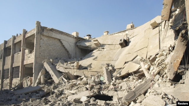 A general view of buildings, damaged by what activists said were missiles fired by a Syrian Air Force fighter jet loyal to President Bashar al-Assad, in Daraya, near Damascus, December 1, 2012.