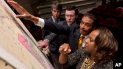 FILE - Lawmakers study a map of the proposed redistricting plan following a meeting of the Legislative Committee on Reapportionment at the Alabama Statehouse in Montgomery, Ala., May 9, 2012. The state's legislature approved new, court-ordered election m