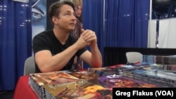 Los Angeles-based Matt Hawkins is a prolific and successful graphic novelist. He had a booth at Comicpalooza, in Houston. He contracts artists from around the world to create the visual realization of his stories.