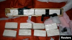 "FILE - The U.S. Drug Enforcement Administration (DEA) of the U.S. Department of Justice released photo shows heroin seized from ""Seaboard Pride"" at Port of Miami, Florida."