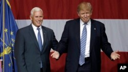 Indiana Gov. Mike Pence joins Republican presidential candidate Donald Trump at a rally in Westfield, Indiana, July 12, 2016.