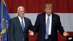 Indiana Gov. Mike Pence joins Republican presidential candidate Donald Trump at a rally in Westfield, Indiana, July 12, 2016. Trump announced Pence as his running mate Friday.