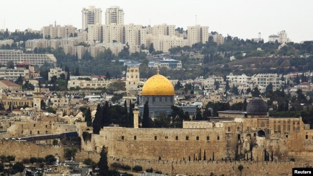 A general view of Jerusalem's old city shows the Dome of the Rock in the compound known to Muslims as Noble Sanctuary and to Jews as Temple Mount, Oct. 25, 2015. Jordan, the custodian of the shrine, says video surveillance project of the shrine is moving forward, but that it's still in the phase of technical preparations.