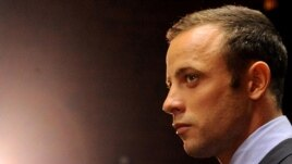 FILE - Oscar Pistorius in court in Pretoria, South Africa for his bail hearing, February 22, 2013