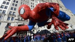 The Spiderman balloon makes its down Central Park West during the 87th Macy's Thanksgiving Day Parade in New York November 28, 2013.