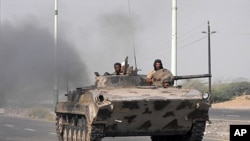 Yemeni Army forces move into the southern city of Zinjibar, Yemen after freeing it from the hands of al-Qaida-linked militants, September 10, 2011.