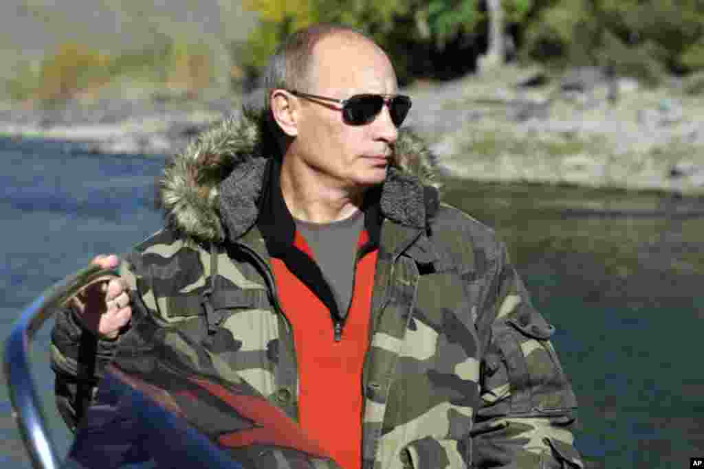 "The image collections on the Russian government site, premier.gov.ru, feature dozens of photos of the president in camoflauge, captioned as ""Vladimir Putin's nature reserve trips."""