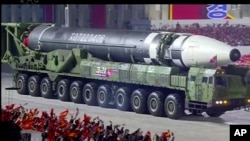 This image made from video broadcasted by North Korea's KRT, shows a military parade with what appears to be a possible new intercontinental ballistic missile at the Kim Il Sung Square in Pyongyang, Saturday, Oct. 10, 2020. (KRT via AP)