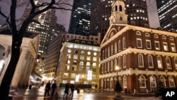 Faneuil Hall, right, is seen at night in Boston. Faneuil Hall is one of the historic sites on Boston's Freedom Trail.