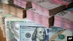 U.S. dollar and Ukrainian hryvnia bills are seen in this picture illustration taken in Kyiv, Ukraine, Oct. 31, 2016.