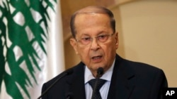 FILE - In this Oct. 20, 2016, photo, Lebanese politician Michel Aoun speaks to journalists after former prime minister Saad al-Hariri endorsed him for president, in Beirut, Lebanon.
