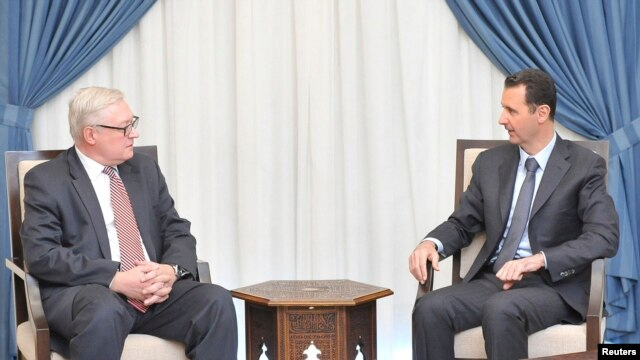 Syria's President Bashar al-Assad (R) meets Russian deputy Foreign Minister Sergei Ryabkov in Damascus, in this handout photograph distributed by Syria's national news agency SANA on September 18, 2013.