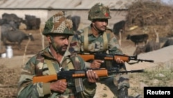 FILE - Indian army soldiers stand guard near the Indian Air Force (IAF) base at Pathankot in Punjab, India, Jan. 3, 2016. India's government has disciplined NDTV Hindi channel for related coverage, drawing media protest.