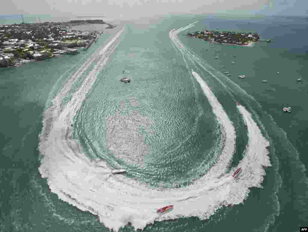 Superboat Extreme class boats make the turn in Key West Harbor during the first of three race days at the Key West World Championship in Key West, Florida, Nov. 6, USA. More than 40 high-speed powerboats from the U.S. and other countries are entered in the competition. (Photo provided by Florida Keys News Bureau/Andy Newman)
