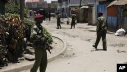 Kenyan police guard the scene following an explosion at a church in Nairobi, Kenya, September 30, 2012.