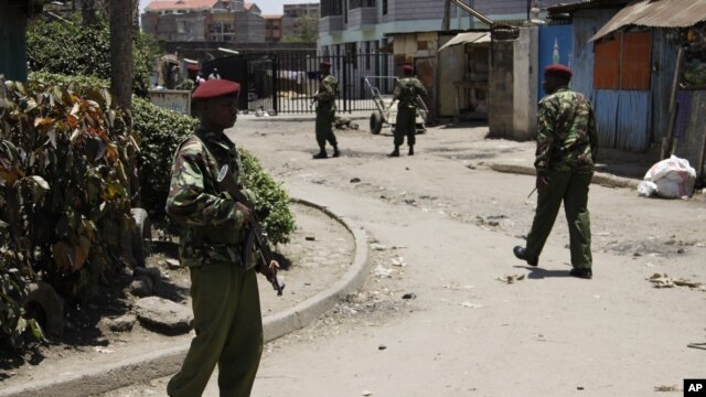 Kenyan police guard the scene following an explosion at a church in Nairobi, Kenya, September 30, 2012.
