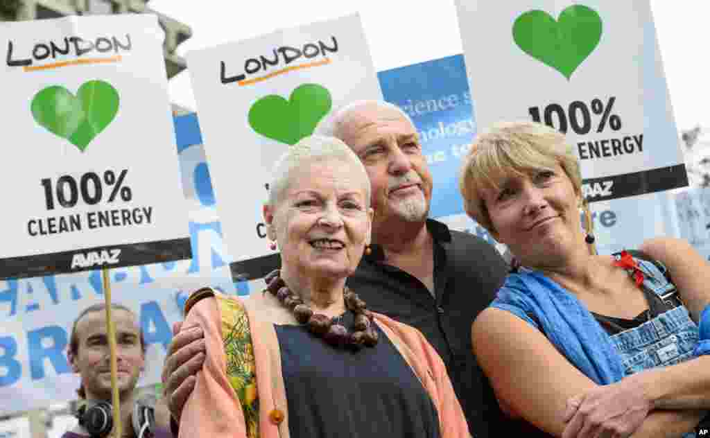 From left, Designer Vivienne Westwood, musician Peter Gabriel and actress Emma Thompson join an estimated 40,000 thousand people marching from the Embankment via Whitehall to the Houses of Parliament in central London as part of the People's Climate March