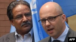 FILE - Robert Piper, (r) then-United Nations Resident Coordinator For Nepal, is shown in Kathmandu on April 24, 2008.