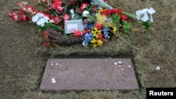 FILE - The replacement grave marker of Lee Harvey Oswald is pictured at Rose Hill Cemetery in Fort Worth, Texas.