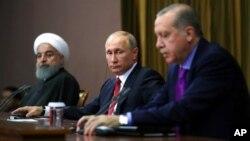 Участники саммита в Сочи - президенты Ирана, России и Турции
