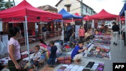 Handicraft and souvenir vendors wait for customers and tourists at the night market of Luang Prabang, October 18, 2009.