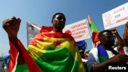 FILE - Ethiopian migrants, all members of the Oromo community of Ethiopia living in Malta, protest against the Ethiopian regime.