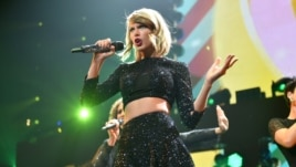 Taylor Swift performs at KIIS FM's Jingle Ball at the Staples Center on Dec. 5, 2014, in Los Angeles.