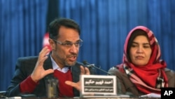Ahmad Fahim Hakim, left, a member of the Afghan People's Dialogue on Peace Initiative addresses a press conference in Kabul, Afghanistan, Jan. 9, 2016. Afghanistan, Pakistan, China and the United States will hold talks in Islamabad on Monday aimed at reviving the Afghan peace process.