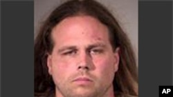 This booking photo provided by Multnomah County Sheriff's Office in Portland, Ore., shows Jeremy Joseph Christian.