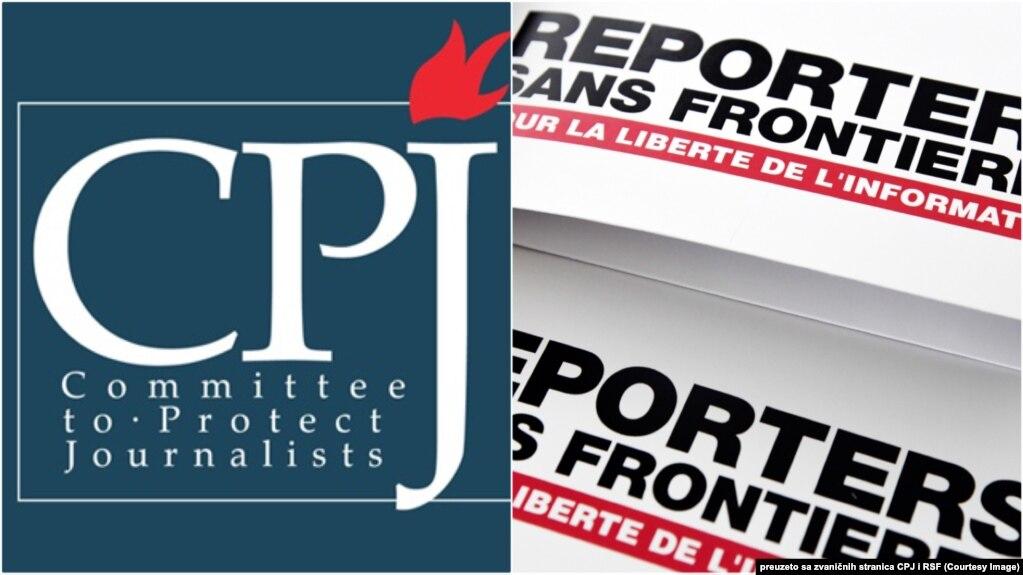 """""""保护记者委员会""""和""""无国界记者""""标识。(photo:VOA)"""