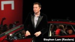 Tesla Motors CEO Elon Musk alights from a Model S