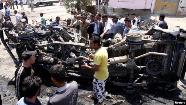 Residents gather at the site of a car bomb attack in Kerbala, 110 km (70 miles) south of Baghdad, April 29, 2013.
