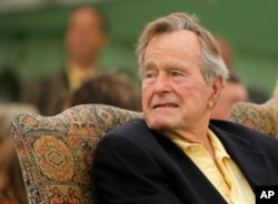 FILE - Former President George H.W. Bush attends a ceremony to unveil a new garden named in his wife's honor, Sept 29, 2011, in Kennebunkport, Maine.