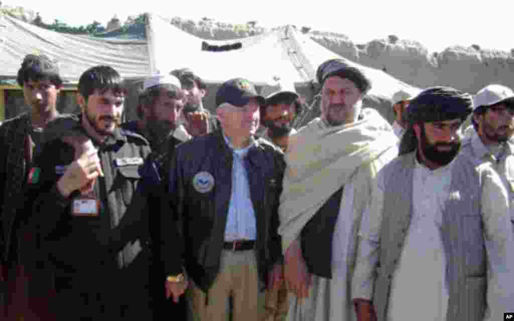 Secretary Gates poses for a photo with village elders in Tabin, March 8, 2011