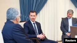 Syria's President Bashar al-Assad (C) meets Alaeddin Boroujerdi (L), head of the Iranian parliamentary committee for national security and foreign policy, in Damascus September 1, 2013.