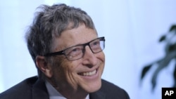 FILE - Bill Gates participates in a media availability , March 13, 2014. Author Susan Cain's new book explains how introverts - like Gates - can be effective leaders.