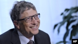 FILE - Bill Gates participates in a media availability on agricultural research, March 13, 2014, on Capitol Hill in Washington.