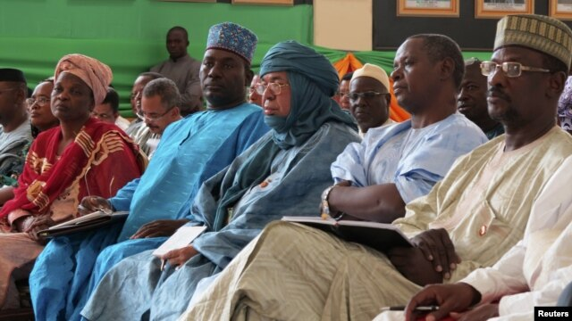 Political figures from northern Mali listen as Mali's Prime Minister Cheick Modibo Diarra speaks at a meeting in Bamako, August 10, 2012.