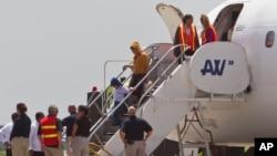 Rombongan imigran gelap yang dideportasi dari Amerika tiba di bandara San Pedro Sula, Honduras (18/7).