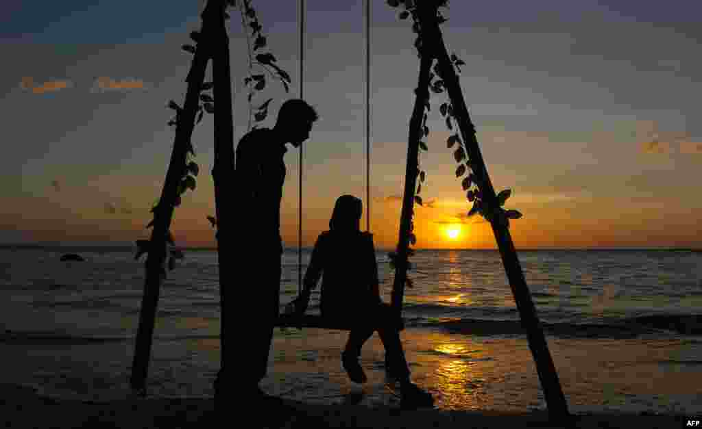 An Acehnese couple enjoy the sunset at Lhok Nga beach on Valentine's day in Aceh.