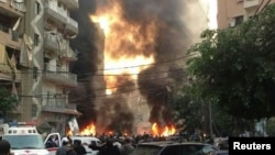 Fire and smoke is seen at the site of an explosion in Beirut's southern suburbs January 2, 2014.