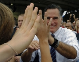 Republican presidential nominee Mitt Romney greets audience members at a campaign rally at the airport in Sanford, Florida, November 5, 2012.