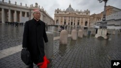 FILE - Cardinal Joseph Zen, of Hong Kong, walks in St. Peter's Square after attending a cardinals' meeting, at the Vatican, March 6, 2013.