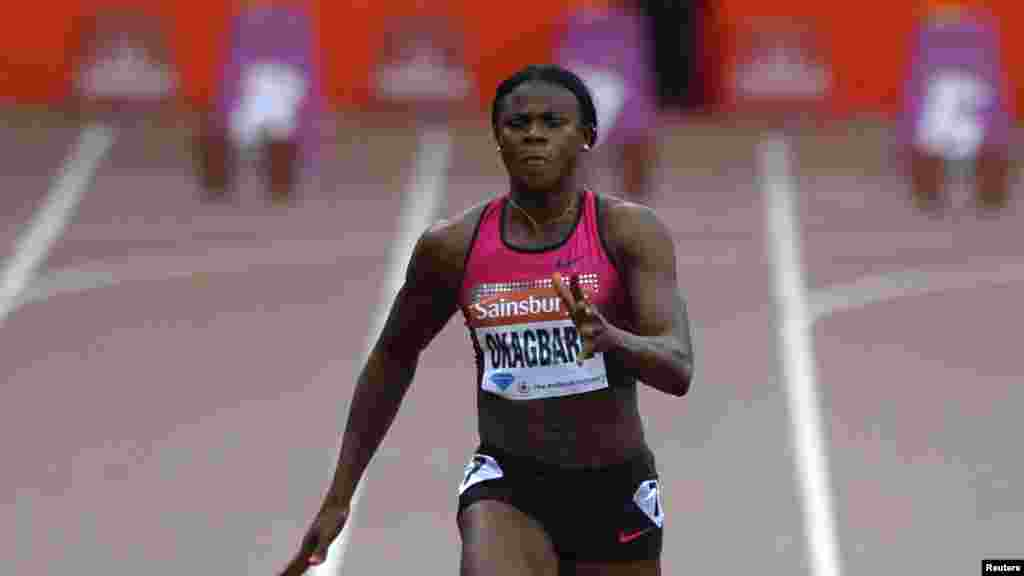 Nigeria's Blessing Okagbare leads the women's 100m event at the London Diamond League 'Anniversary Games.'
