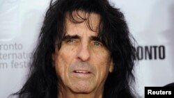 FILE - Alice Cooper poses on the red carpet during the 38th Toronto International Film Festival in Toronto, Sept. 7, 2013.