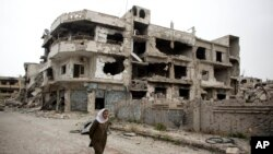 FILE - A devastated part of Homs, Syria.