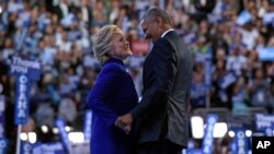 President Barack Obama, right, talks with Democratic presidential candidate Hillary Clinton, left, following Obama's speech at the Democratic National Convention in Philadelphia, Wednesday, July 27, 2016. (AP Photo/Susan Walsh)